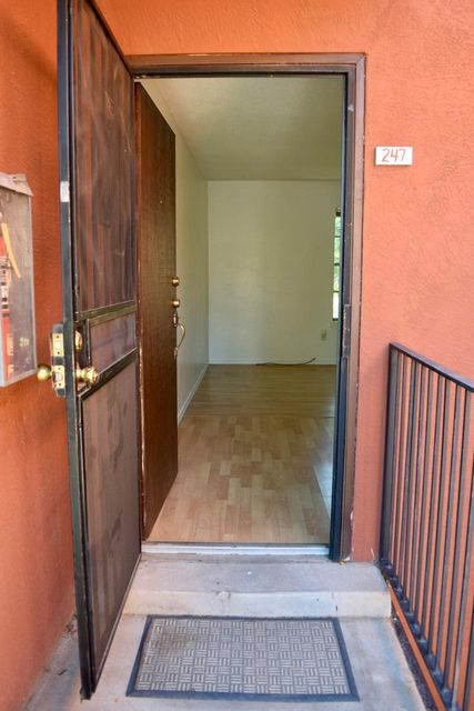 Great 1 bedroom condo in good condition with laminate wood flooring! On 2nd floor with a nice view of landscaped common area. Eagles Nest Condo complex is near Kirtland and UNM. Large closet in master bedroom.