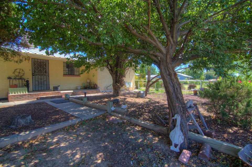 This property is listed under MLS Number 902123. This price includes the other .90 acre lot 2 apartments. plus main home and huge shop.