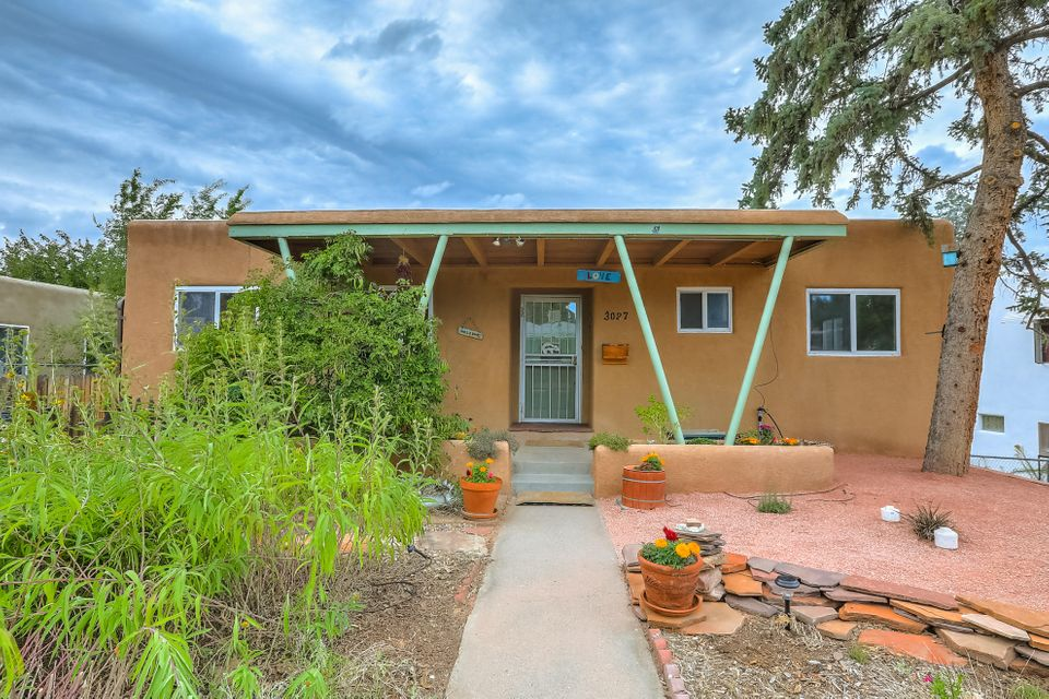 Beautiful home near Hyder Park and Bandelier Elementary School. Recently refinished hardwood floors, freshly painted, and newer windows are just a few of the amazing features of this home. The bright and airy kitchen offers ample cabinet space, custom tile, and the perfect view out the window to the front vegetable and herb garden. Two spacious bedrooms and a full bathroom upstairs,  a master bedroom downstairs as well as an office/bedroom and second family room. Storage, storage and more storage in this well laid out home. The upstairs oversized deck is perfect for entertaining or dining al fresco. The backyard has mature landscaping, a secluded hot tub escape, a fenced garden for edibles, and two additional storage structures. Schedule your showing today!