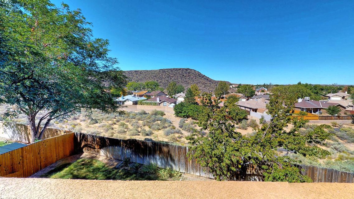 Stunning High Quality Renovated! OPEN THIS Saturday 12-2pm. See VIRTUAL TOUR! SPACIOUS CUSTOM 5 BEDROOM in established neighborhood. Stellar Views! Privacy! Backs to Petroglyph Nat\'l Monument! Excellent floor plan perfect for multi-gens, in-laws, teen wing, a large family and/or hobby/home office space! 3 Spacious main level bedrooms, including Owners Suite + 2 spacious bedrooms on full walkout level. Lots of windows & light! You\'ll be surprised by the amount of square footage & gracious space beyond the front door. Solar PV Panels, low maintenance Eco flooring, custom built-ins, abundant storage, awesome family room. New Stucco, New Courtyard, New Roof, New Windows, New Trim, New Paint, New Appliances. Solar heated garage, grassy yard. Proximate to Cottonwood Mall, Costco, Downtown, APO