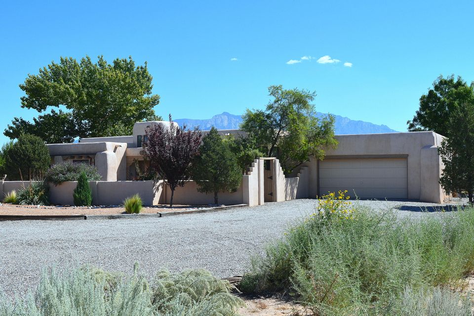 Classic Corrales charm with Views of the famous Sandia Peak! Bring your horses to their new home with Barn, 4 stalls and Corral. Enjoy the New Mexico weather under the covered porch or in the private courtyard. This 3 BR 2 BA home invites you to stay. The comfortable single level layout with 2 living areas provides room for the whole family. Southwest decor with exposed adobe walls, tile floors, Vigas, Latillas and Beam ceiling and a custom Kiva fireplace. It's Postcard Pretty and priced to sell. Also, offers plenty of room for your RV or horse trailers. Easy access to the Barn (which you could convert to a shop if you prefer) and easy access to parking make this home stand out. Come see the value this home offers and you'll agree.