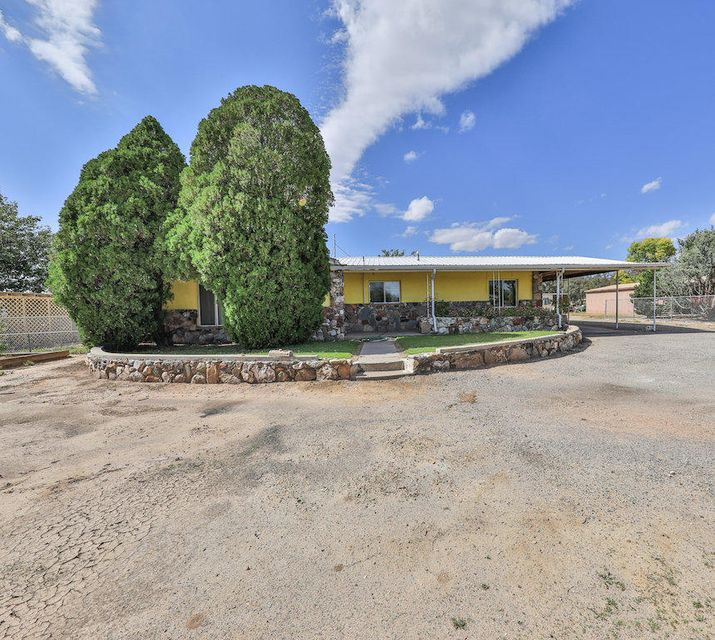 Check out this Large home with a Guest house/Manufactured home. Main home - 3 beds, 2 baths, 2413 SQFT fireplace, large living area and a den. Guest house or mother in law suite - 3 beds, 2 baths, 1349 SQFT, 2 sheds/workshops. Its situated on 5.24 acres in the heart of Los Chavez. There is a 50x40 FT shop and extra shed and both include 220 Outlets on a concrete slab. Total of 2 carports, and plenty of garage space. Large RV/boat/trailer carports attached. Concrete ditch irrigation. With some TLC and new carpets these homes have some amazing potential! Don't miss this great opportunity!