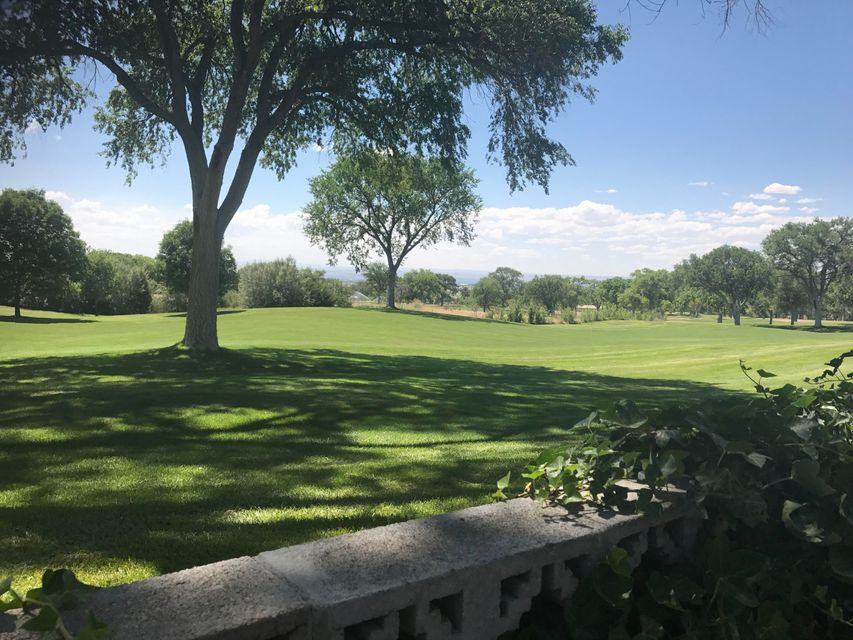 Beautiful Views from this Golf Course Lot!  This home backs to the Four Hills Golf Course, giving you incredible views of the City of Albuquerque! The club house is just a short walk away.   What a great deal!  This home is spacious and full of potential. With updating, you could create a wonderful home for entertaining, OR  you might be able to have an assisted living facility with income potential.  Roof Warranty transfers. Square footage per appraisal is: Living Area 3,488 sq ft; Sunroom/enclosed porch 646 sq ft; Garage 515 sq ft; open porch 294 sq ft (sq ft approximate) . This is a Must See!  Sold 'As Is' . REC Considered. Exchange Considered.