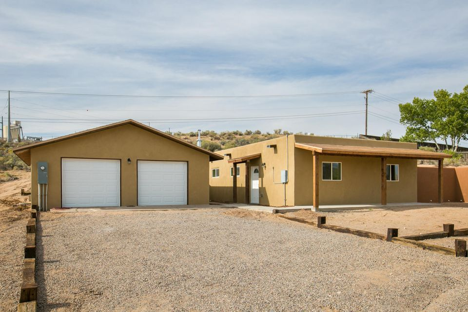 Beautiful 1.2+ acre lot in a established corrales Neighborhood with AMAZING views. . . Owner of property will consider Owner financing w/ large down, See lo/so for infoLock box on Meter right side of Gate..