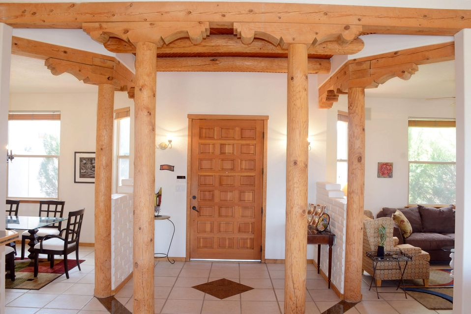 Views of City, Mountains and Balloons from every room on the west side of this lovely custom built, one owner home in the Old Mission Estates sub-division. Large open kitchen with granite counters tops, stainless, bar, formal dining room, two living areas, and two separate sleeping areas. Located on the north side of this lovely home is a large master suite, huge bathroom, with side by side vanities, large oval Jacuzzi bath, separate shower and enclosed commode, large walk-in closet and a second bedroom/office. South side hosts three bedrooms, one bath, large laundry room with sink and garage entrance. 12 foot ceilings, with vigas and latias compliment the large windows all  along the east side of the home. Barbecue and large walled outdoor living space has gas hook-up for outdoor living.