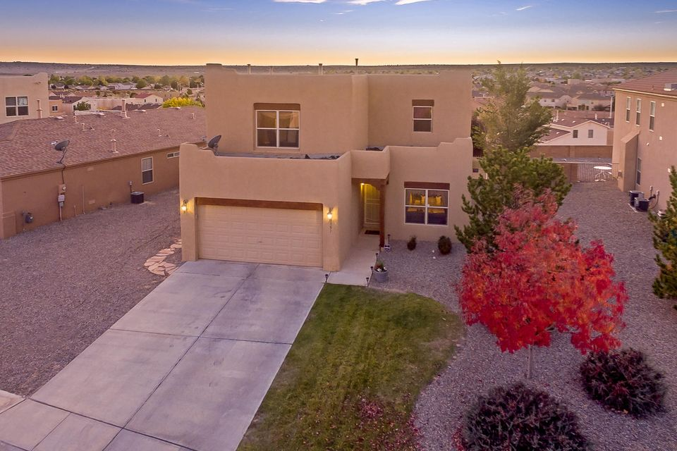 Enjoy New Mexico sunsets relaxing on your private balcony in this upgraded 4 bedroom home with plenty of room for the whole family! Tongue and Groove ceiling compliments the warm wood flooring and fireplace in the  inviting family room. Granite, covered patio and all the amenities.  This home is move in ready and just waiting for you!  Security system hardware is owned and will convey if buyers continue contract.  They will receive two months free service.  If buyers not wish to continue contract, seller will remove existing hardware and leave previous system for buyers to connect at their option.