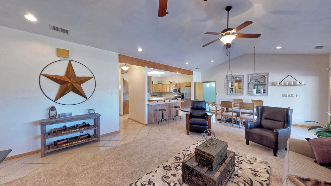 Great home and property located in the heart of Corrales!! Very well cared for and maintained property with many amenities. Open floorplan to enjoy all your family gatherings. Large updated kitchen that opens up into the dining and living room area with island counter seating. New carpet, refrigerated A/C, spacious laundry room and large covered outdoor patio to enjoy those beautiful New Mexico Evenings. Home is located on large 1.87 acre lot with Mountain Views from the front yard. Lot has potential for horses or agriculture possibilities. Do not miss the three car garage with workshop and half bath. The garage has heating and cooling with many possibilities. Don't miss this Corrales Gem that awaits your vision!!