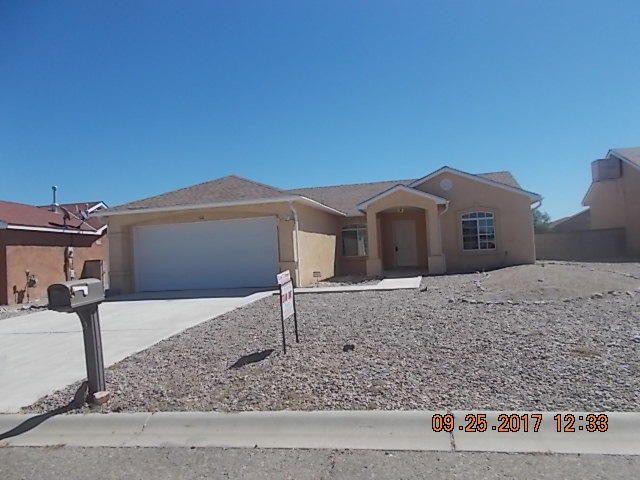 This is a super nice home with many desirable features.  Casual dining room off of kitchen that boast lots of cabinets and work surface.  Open and light, the living area opens up to a covered patio. Large Master bedroom with private bath and walk in closets. Walled in back yard great mountain views. Close to all schools and UNM