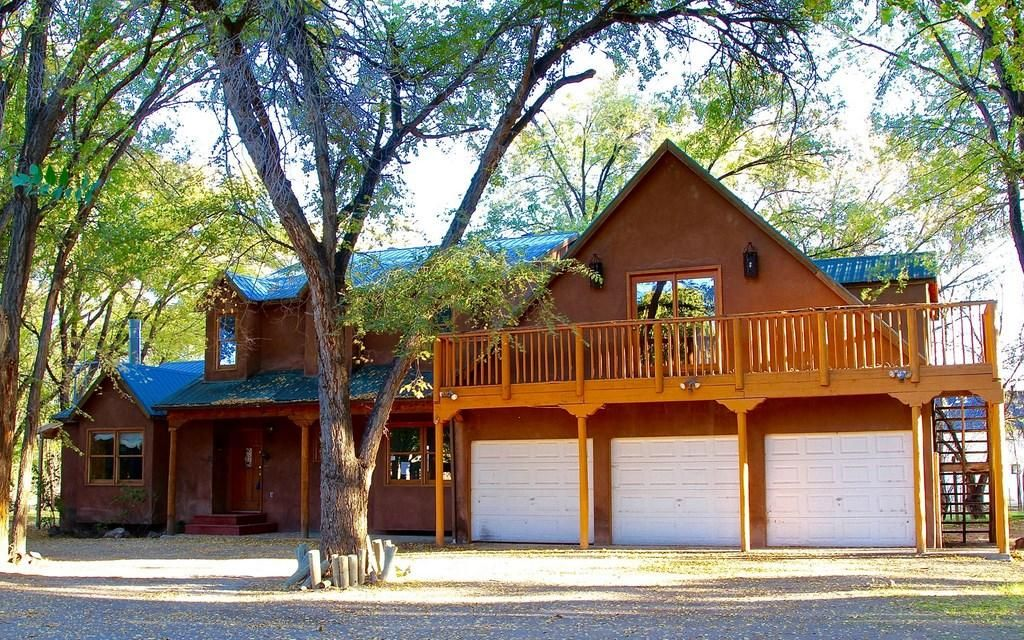 Great opportunity on an excellent 4 BR Corrales home on over an acre by the Bosque. With an attached 3 car garage & an additional detached garage/workshop area. Also features formal living room with fireplace, formal dining room, Den & kitchen with granite counter tops & island. Master BA features jetted tub and remodeled snail shower. Beautiful lot with tons of shade and privacy