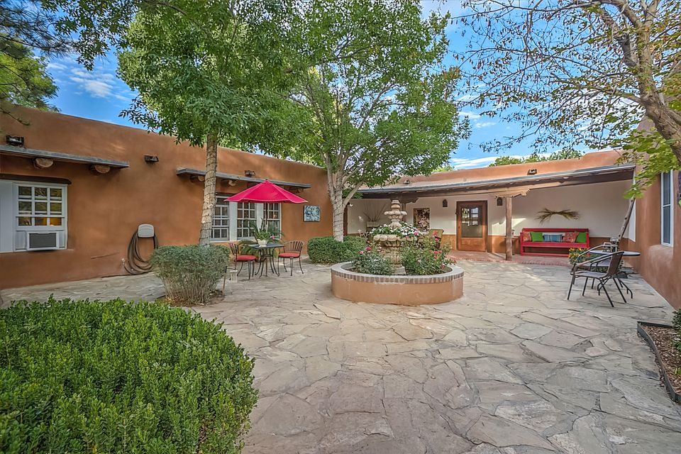 Stunning Classic Adobe Estate On 3.41 Lush Acres With Fabulous Horse Facilities, Including 4-Stalls, Round Pen, And Huge Horse Arena. Park-Like Setting With Lush Grass, Cottonwoods, Courtyards, Portals, & Patios. Walking Distance To Bosque Trails And All Amenities. Main Home Is Approx. 4000 S.F. And Features Chef's Dream Kitchen, Two Living Areas, Seven Fireplaces, Wood & Brick Floors Through-Out. Inviting Courtyard Welcomes You To This Special Home That Exudes Warmth, Comfort, And Lots Of Old World Charm. Separate Guest House Has Two Bedrooms, 2 Baths, 2-Fireplaces. Total Acreage Includes 2 Lots. Not A Horse Person? Grow An Incredible Vineyard On Prime Land!!
