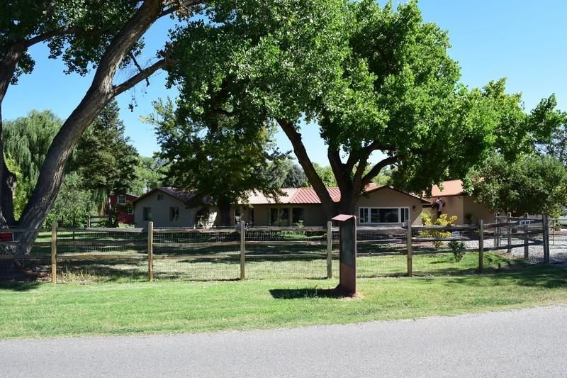 Beautifully remodeled ranch style home on 1.87 fully fenced acres, 800sf barn plus full loft, 1012sf 4 car garage, 38 mature fruit trees, large cottonwood and willow trees, pond, irrigated. Home includes 11 rooms- family, living, dining, kitchen, laundry, pantry, master bath, hall bath, master bedroom, bed 1, bed 2. Upgrades include new floors, doors inside and out, hardware, kitchen and bath cabinets and granite tops, appliances, alarm, window coverings, new windows as needed, jetted tub, barbeque area, ductless heat pump for heat and cooling, ceiling fans and L.E.D. inside and out, copper metal roof, bronze metal soffits, synthetic stucco on two to four inch styrofoam, wood stove.