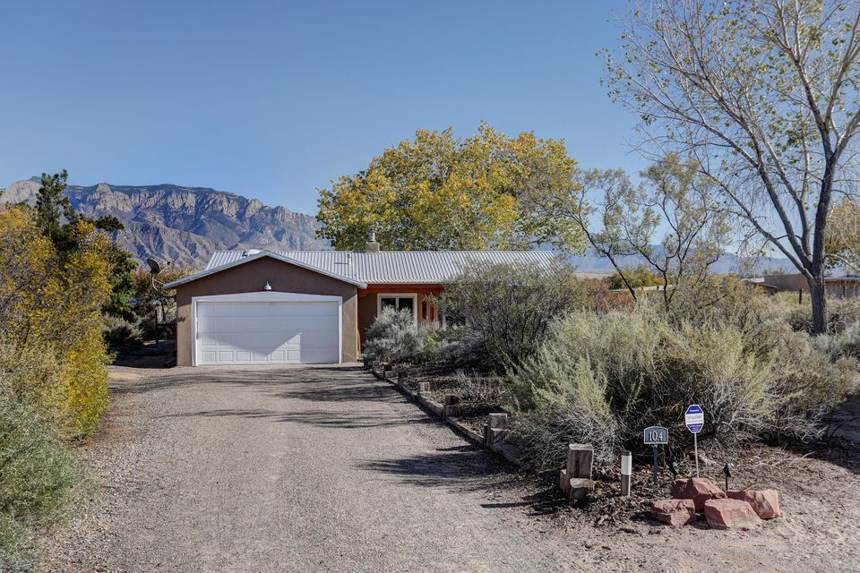 Treasure located on Peaceful Corrales Cul de Sac, Horse Arena & Amazing Mountain Views. Northern NM style home with beautiful updates to impress any Buyer. 2 Living areas & dining rm, Kiva wood burning fireplace in living rm. Great rm with Pellet stove, shiplap wall & gorgeous Mtn Views. Stunning kitchen, Cherry cabinets, granite counters, tile backsplash, SS appliances & sink, gas Dacor range. Newly painted inside & outside, all new interior & exterior lighting. Master bath features barn door, jetted tub, walk in shower. Tankless WH, newer metal roof, refrig air. Spacious flagstone back patios for entertaining & enjoying the views. Horse arena w/2 run-in shelters & tack shed. Gated direct access to rear of property. RV/extra parking in front. PERFECT for quiet country living in style!