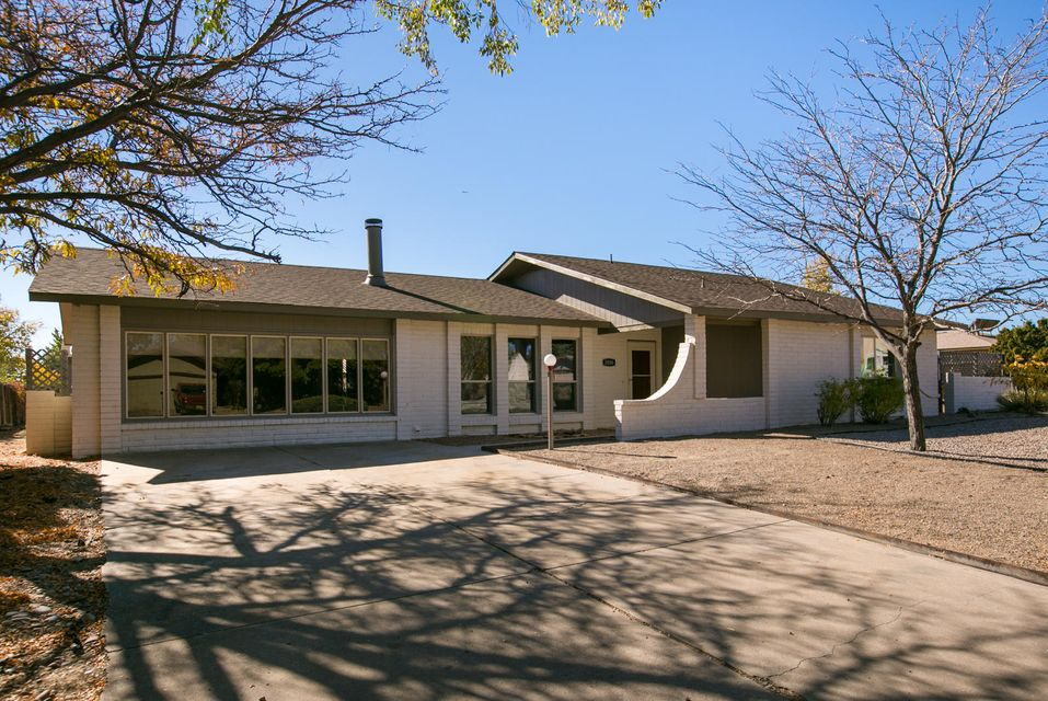 A fabulous remodel by Rio Grande Homes! This excellent floor plan has brand new roof, siding, windows, flooring & plumbing-no poly!  A brand new kitchen, all cabinets, sinks, fabulous granite!. A 400 sq foot great room as well as a family room.  Sun drenched patio is heated and cooled!  New fans & lighting throughout.  A detached garage, w/all new roof, siding and doors.  Huge yards front and rear with parking for RV's boats, atv's, garden area, stubbed out for outdoor kitchen!!  100% new windows, low E, make it sound proof and cozy!.  Large bathrooms, new toilets, and vanities.  Tile shower and floors in the main.  Great storage, excellent interior laundry room. Very nice pantry and custom buffet with gorgeous granite top.  We spared no expense making this your dream home.