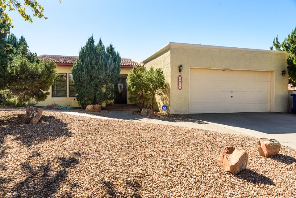 ** OPEN HOUSE ** Saturday, 11.18.17 from Noon to 2pm. Just Imagine pulling into your garage in the FOOTHILLS and thinking Wow WE actually live here!!! All one one level! Light and Bright open floor plan with a fireplace, which is ideal for the upcoming winter months. New roof and Parapet redo in 2016. Spacious Kitchen w/ corner cabinets with a Lazy Susan for no wasted space! Lots of cabinet space! Large bar top for entertaining, a breakfast nook, as well as a dishwasher and built-in microwave. The master suite offers an attached full bath with a tub and separate shower. The backyard offers flagstone walkways and low maintenance landscaping. Corner lot with lovely views of the Sandia's! This one won't last long!