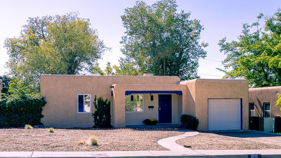 A Pueblo-style casa on Constitution just 3 houses east of Summit Park! Classic UNM-area 1-level floorplan with two bedrooms, one full bath, living room, dining room and kitchen. Hardwood floors and coved ceilings. Granite counters in kitchen. Thermal windows. Water heater and evap cooler both new in October 2017. One car garage with opener. HUGE backyard with storage building, playhouse and dog run. Welcoming front porch + wood deck. Easy-care front yard landscape; the backyard awaits your special touches. Close to law/med schools and golf; easy access to Nob Hill and Downtown.