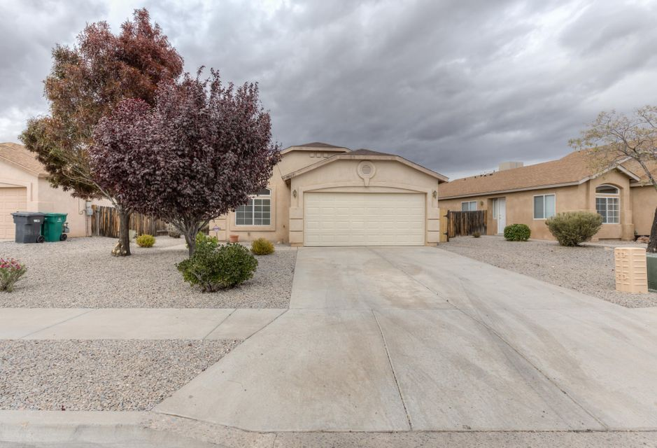 Charming 3 bedroom, 2 bathroom move in ready home.  Front and back yards are fully landscaped and include mature trees.  Home includes two living areas and a formal dining area.  The house is conveniently located near schools, shopping, highway access, and within a block of a park.  Front yard views of the Sandia Mountains.
