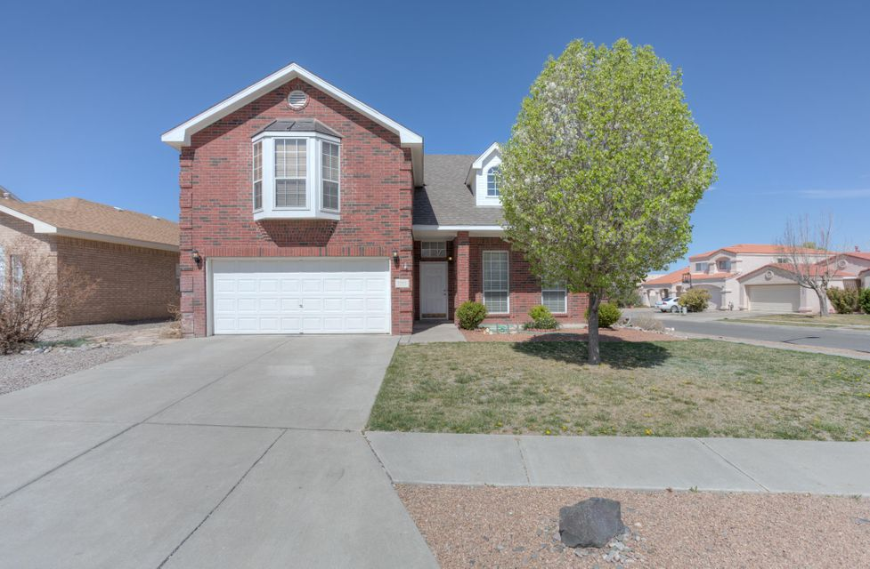 This 2 story Oppel Jenkins is conveniently located in the Willow Wood subdivision on a great corner lot. Natural light provides a wonderful backdrop for the stunning views of the Sandia Mountains. Spacious LR/DR combo, open floor plan, cozy fireplace, ceiling fans, skylights, security system and refrigerated air.