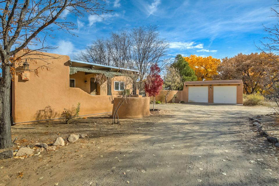 Charm , Character and Craftsmanship only starts to describe this unique one of a kind home nicely situated on an acre. Attention to detail in every corner. Lovingly handcrafted moldings, hand carved doors, light fixtures & wood burning stoves. Adobe interior walls skylights, laundry room with 1/2 bath. 100% solar energy, panels owned by seller. 3 carports, 2 separate  detached garages, 1 could be workshop. 2 wells, one domestic, one irrigation. Don't overlook the adobe playhouse and kiva doghouse in backyard  courtyard. Detached casita with 3/4 bath for guests or make into an artist studio! This exceptional home has been meticulously maintained. Only loved by 2 previous owners, you could be next!