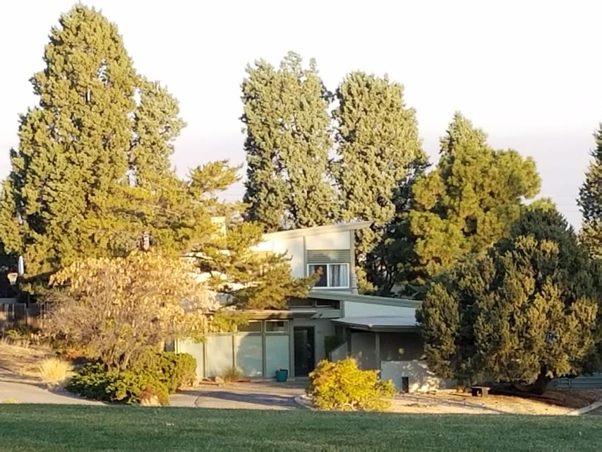 Don't miss out on this special opportunity to own a piece of history in the Netherwood Park neighborhood!  The ''Walker House'' on Netherwood Park is a unique vintage mid-century modern custom design home -- the early residential work of acclaimed architect Donald P. Schlegel, first Dean of UNM School of Architecture, designer of The Robb House & mentor to world-famous architect Antoine Predock. Custom designed from the ground up to capture New Mexico's enchanting light from sunrise to sunset, the wide variety of windows & angles offers fantastic views of the Sandia mountains and Netherwood Park!  The living room w/fireplace & built-ins features floor to ceiling windows facing the park.  The main floor living areas including kitchen & dining, are open & perfect for large or small gathering