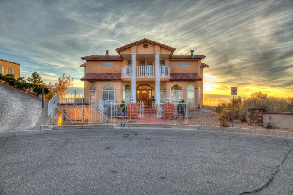 Amazing Cul-de-sac View Lot Positioned Perfectly In The Foothills Of The Sandia Mtns To Provide Unobstructed/Sweeping Views Of City & Sunsets/Truly 1 Of Choicest View Lots Available. Gorgeous Home Featuring A Lite/Brite Open Flrpln Enhanced By Windows Galore To Enjoy Amazing Panoramic Vistas/Versatile Sleeping Quarters W/2 Brs On Main Level/Gourmet Kit W/Sunny Brkfst Nk/Formal Dining Rm + Game/Media Rm For Entertaining