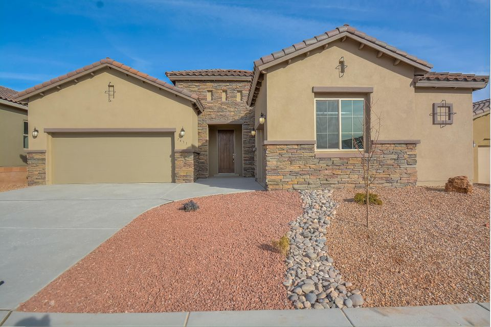 Stunning Tuscan single story home by Hakes Brothers located in the Trails neighborhood! Home features 2,374 sf with 4 bedrooms, 3 full bathrooms and 3 car garage! Beautiful wood tile throughout the main living areas. Spacious great room with custom trayed ceiling. Open kitchen with upgraded charcoal cabinetry, granite countertops, backsplash, gas cooktop, built-in wall oven/microwave, center island with seating space, pantry and dining area. Gorgeous master suite with private entry hall and bath. Bath hosts a walk-in shower with tile surround, dual sinks and a huge walk-in closet. 3 additional gust rooms with plenty of space. Outside enjoy the covered patio and private backyard. Come see what the Hakes Brothers has to offer!