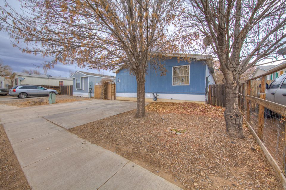 Great home close to village of Los Lunas. Lots of new industry coming. This home is about 10 min from I-25. Enjoy this 4 bedroom open light and bright floor plan with cozy fireplace and open kitchen. Master bedroom separate from secondary bedrooms. Fenced yard with dog run. This home is cute and ready for immediate occupancy.