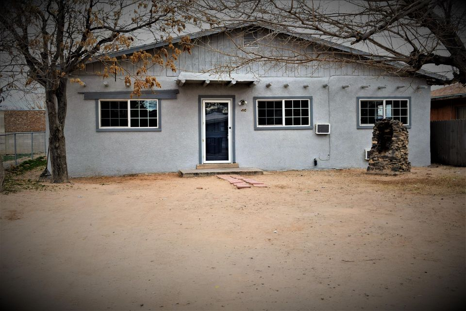 Wonderful 5-possible 6 bedroom home on a large lot with back yard access. This home is move in ready with fresh paint and new laminate flooring, new carpet. Newer windows, new range and range hood. This home sits on a larger lot with back yard access. This home is a must see & priced to sell!