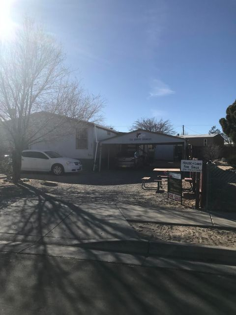 48X24 double-wide manufactured home with extensions on both sides. One bedroom casita in back. Two-car carport. Workshop and storage shed in back. Property to be sold in ''as-is'' condition.