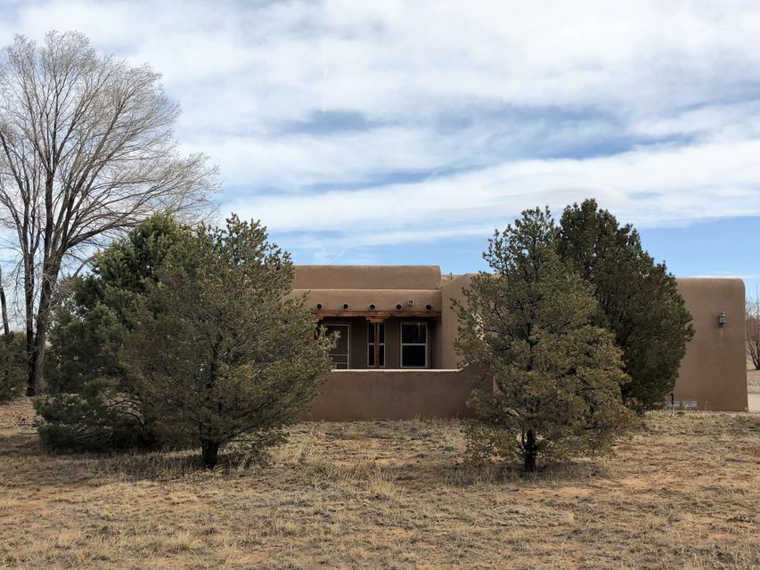 Country Living Just 25 Minutes to Albuquerque! 3 Bedrooms & 2 Baths! Located on 2 Acres w/ Mountain and Prairie Views!2 Mi to Wal-Mart SuperCenter, Dining and Schools! Year round Paved Roads and Driveway! Lots of Light, High Ceilings, Cozy Fireplace, Community Water. Four Bedrooom. Just painted and New carpet. Move in ready.A great place to call Home!