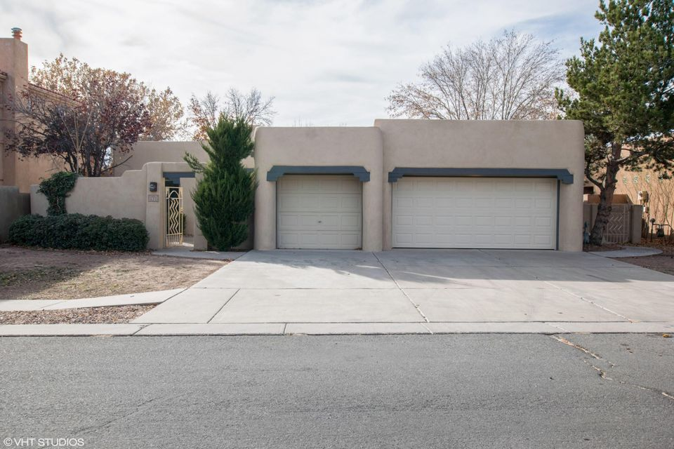 Excellent pueblo style 3 BR home at a supreme location. This North Valley gem has hand carved wooden columns, wood ceilings with tongue & groove vigas, and a brand new roof. Huge kitchen featuring new granite counter tops, brand new stainless steel appliances, a double oven, cook-top range, and kitchen island!There is brand new flooring throughout and the home has been freshly painted.  Zoned radiant heating, skylights, new air conditioners and so much more! Perfect location to commute from(right in the middle of town!). This is a Fannie Mae HomePath owned property.
