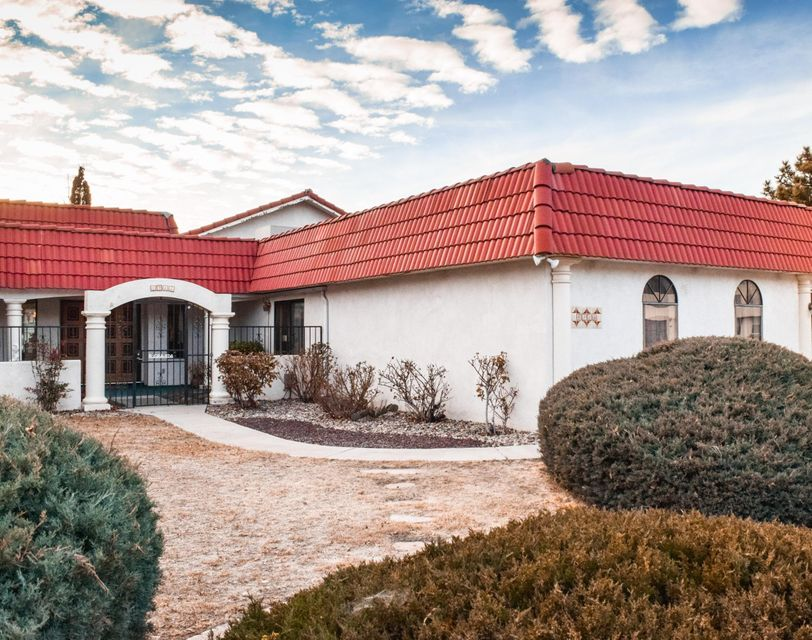 VIEWS VIEWS VIEWSTHIS IS THE ONE YOU HAVE BEEN LOOKING FOR!!Welcome home to 4915 Camino De Monte, a palatial home with mountain and sunset views available on the market for the first time in almost 30 years! 4915 Camino De Monte boasts 3 bedrooms, 3 baths, an elegant dining area, and a kitchen with a cozy breakfast nook. The large luxurious living area has raised wood beam ceilings, views, a fireplace and a wetbar that's perfect for hosting epic gatherings for family, friends and business associates. You also have an indoor sunken hot tub where you will relax and enjoy gorgeous New Mexico sunsets.