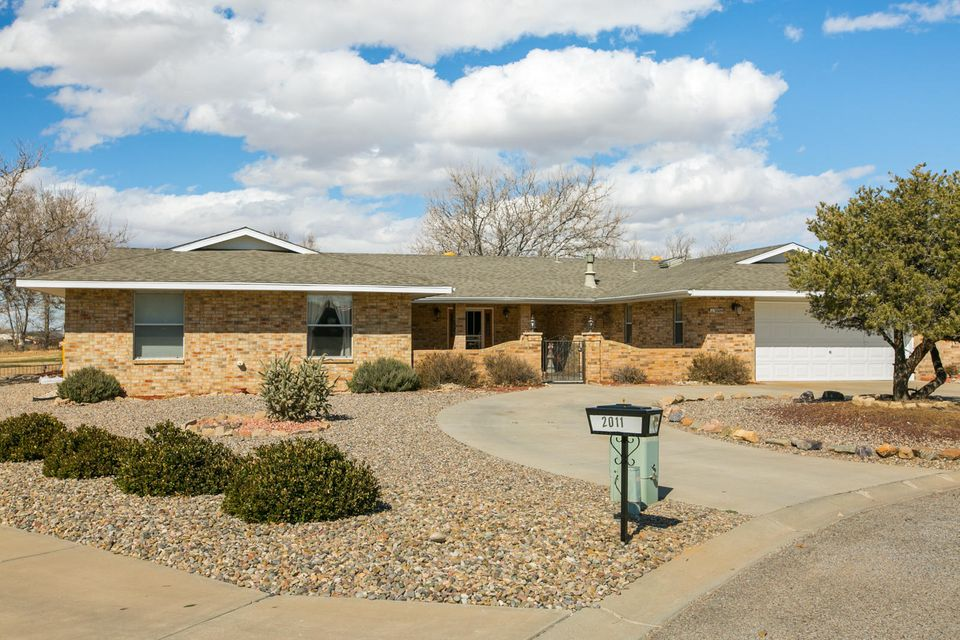 THIS HOUSE IS IMMACULATE,-sunken living room-open floor plan-large master bedroom-large master bath- 4 walk in closets- 7 Sky lights-Wet Bar-Circular driveway-Brick constructionyour are sitting on the 14th hole of the golf course-quiet culdasac-quiet community in Belen New Mexico.25 minutes from Facebook Data Center45 minutes from Albuquerque1 1/2 from Sante FeYou need to see this house. See LO/SO remarks for appointment