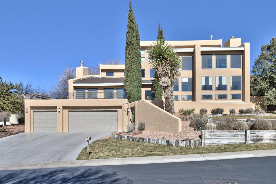 PRICE REDUCED. Wonderful mountain views from this large 5 bedroom Custom Home located in the exclusive gated community of Tanoan West.  Home has been completely remodeled with hardwood floors in bedrooms and living areas with custom tile and quartz in its 4 bathrooms.  Livingroom and master suite have stacked stone fireplaces.  The kitchen is outfitted with contemporary cabinets, gas appliances, quartz countertops and casual bar seating.  The master suite is separate from the other bedrooms with double sinks, soaking tub, separate shower and walk-in closet.  There is additional space for your hobby, mom, guest or nanny in a private area with its own bathroom, walk-in closet, laundry, sitting room and exterior door leading to a walled-in patio.