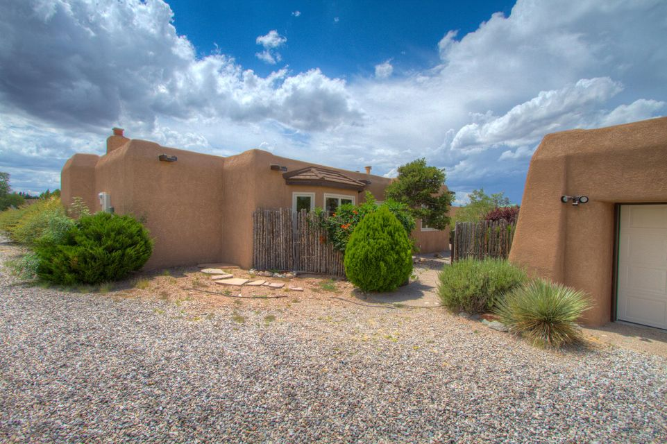 ***Owner Financing Available*** Mountain AND Mesa VIEWS! This Tom Ashe custom single story home has ZERO steps! Easy, quick access to I-25 for trips to Santa Fe and Albuquerque. LOTS of natural light. Open kitchen. Pellet stove, kiva fireplace and radiant floor heat make this gem cozy in the winter.  Saltillo tile floors in main area of home. New carpeting in bedrooms. Two courtyards, detached 2 car garage. Quiet, friendly neighborhood. This energy efficient home has a BAC Lifetime 50 mil PVC membrane roof w/ Steel Shingles over Bow Window, exterior Re-Stucco by BW Earp,  Anderson windows and a tankless hot water heater. New septic system. Move-in ready!