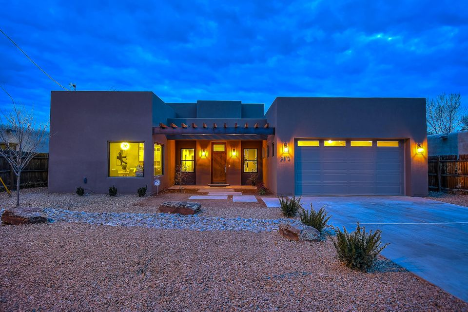 Welcome to this luxurious, newly constructed home in the desirable North Valley. Situated down a dead end street, this location has all of the privacy you want while still within walking distance to Flying Star, El Patio, & easy access to walking/biking trails. The curb appeal is perfection with a xeriscaped yard, steel-covered beams, & large picturesque windows for light & bright living. This stunning transitional style home will ''wow'' you from the moment you walk in with cathedral ceilings, an open concept design, beaming white quartz countertops, custom cabinets and a spacious separate formal dining. Open the living room to the covered patio with wall-to-wall sliding glass doors to a fully landscaped back yard. Home is a Brian Harris & Evan Thompson original presented by Harris Homes.