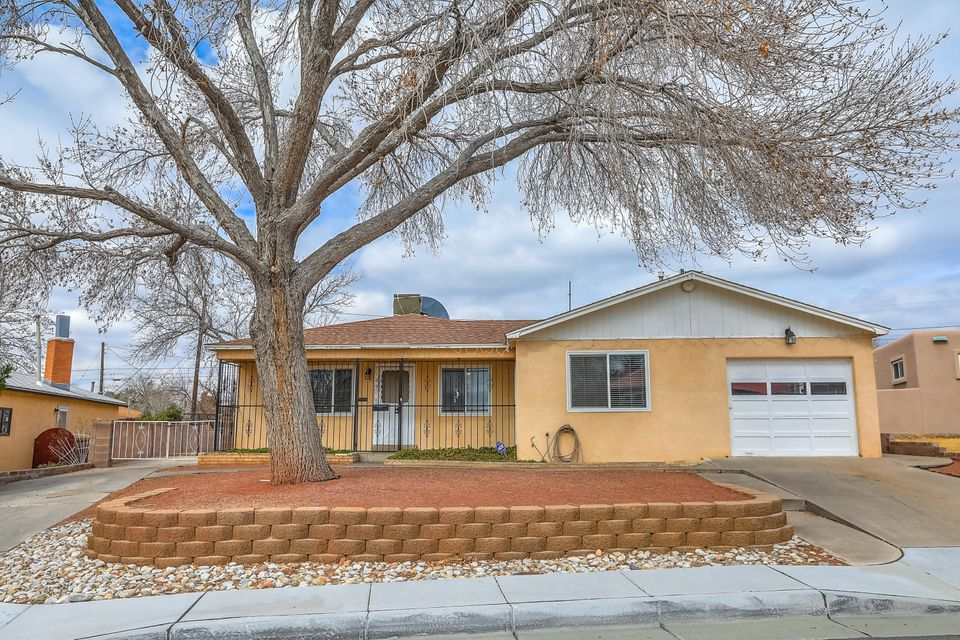 GREAT NEW PRICEDelightful single story in quiet Snow Heights neighborhood.   In walking distance to Collette Park Elementary School.  Newer Windows.  Updated Baths and Kitchen. Two Living Areas including Den with wood burning fire place and separate outside entrance, great for a home office as well.   Not included in the Square Footage is  a 440 Sq Ft sunroom/ playroom/ hobby room.  Newer evap cooler and water heater.   Two driveways with access to backyard for RV/boat/trailer etc parking.  Low maintenance yard.  Backs to arroyo open space with view of the mountains.   Come make this house your home today!!!
