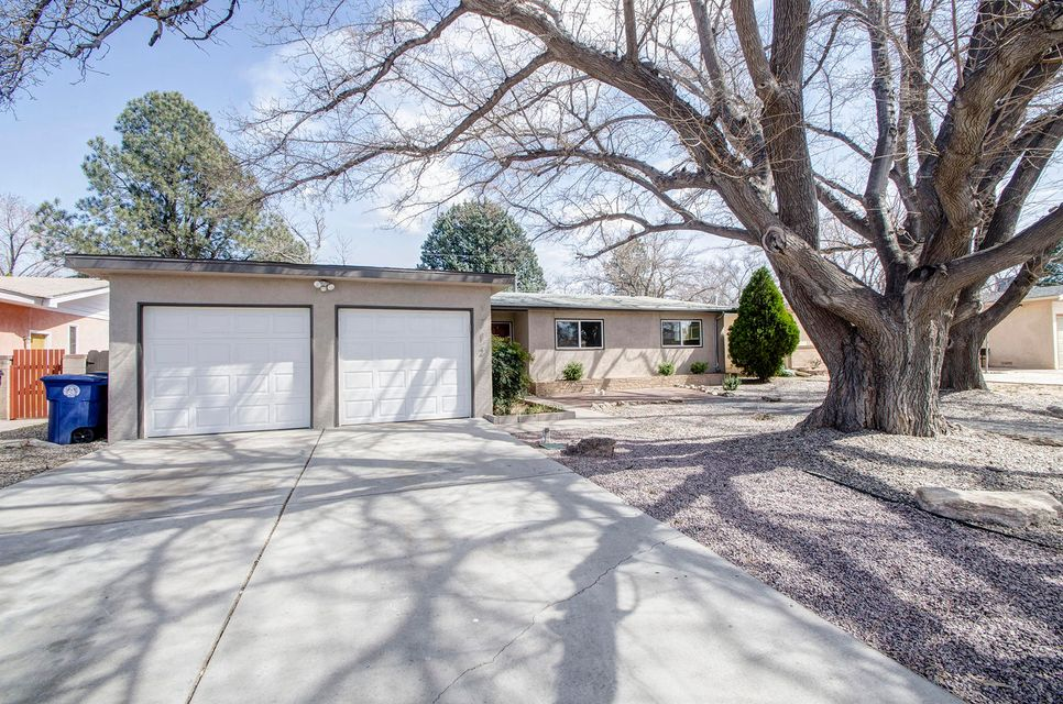 Open Functional Floor Plan with huge Living and Entertaining Space.  Upgraded, Updated and Move In Ready! Updated Kitchen with Granite, Built in Cooktop/Stove, wood floors, Updated Bathrooms with gorgeous tile work.  Huge rooms, large Backyard, see though Fireplace adds comfort and style to this Modern Ranch style home - Truly a Must See! Super Convenient location to ABQ Uptown and easy I-40 Access.