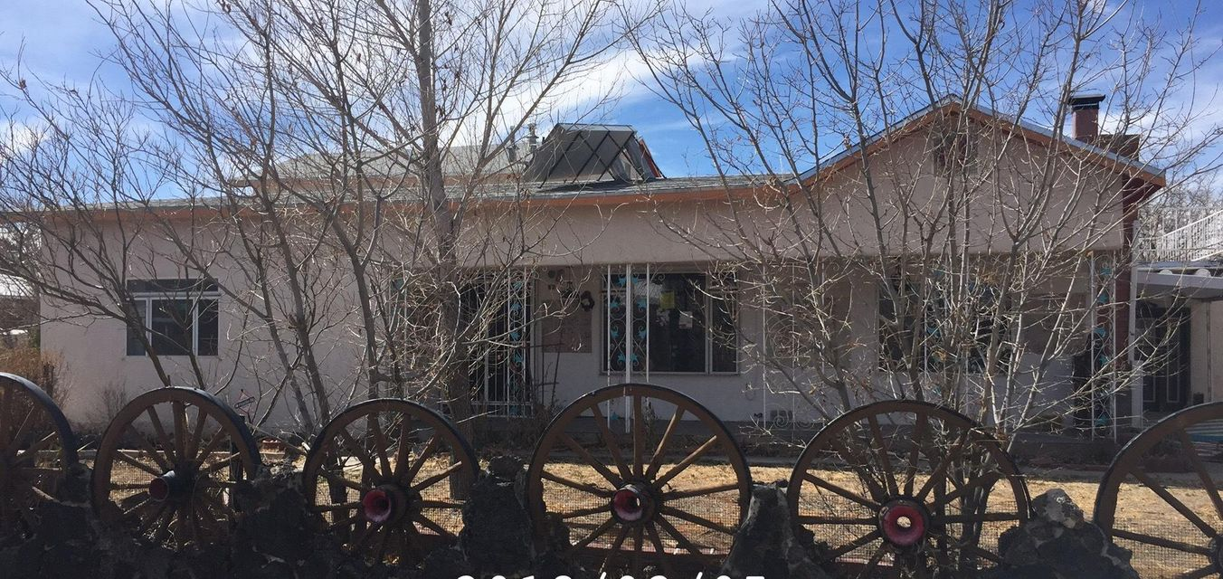 The Heart of the North Valley!    Quiet Living close to the freeway.  Corner lot with a carport.   Family room has a wood burning fireplace and wood beam ceilings.  Kitchen features wood floors and a breakfast nook.  This is a lot of home with a ton of potential!