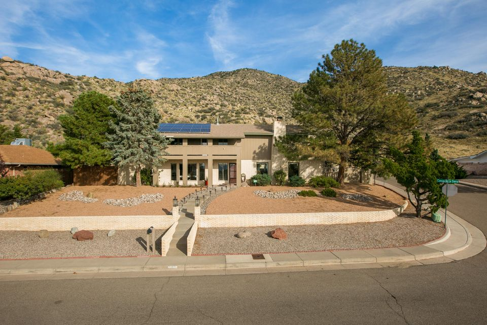 The magnificent custom home perched on a hill with breathtaking mountain and city views backing to foothills open space! This property features grand entry, 5 bedrooms, including two Master Suites, one on the main level and one upstairs, two living areas, 4 full bathrooms,an elegant formal dining room, breakfast nook, 3 fireplaces,grand library with  built in walls of bookshelves. Gourmet kitchen with granite countertops, designer paint. No carpet!  Loads of upgrades inside and out!Perfect for people with allergies.  It has an attached two-car garage, plus a large storage shed. The back-yard is park-like and private - providing some gorgeous private spaces to the home. Hiking and bike trails are just steps away. Enjoy enchanting sunsets from the private balcony. Multigenerational heaven.