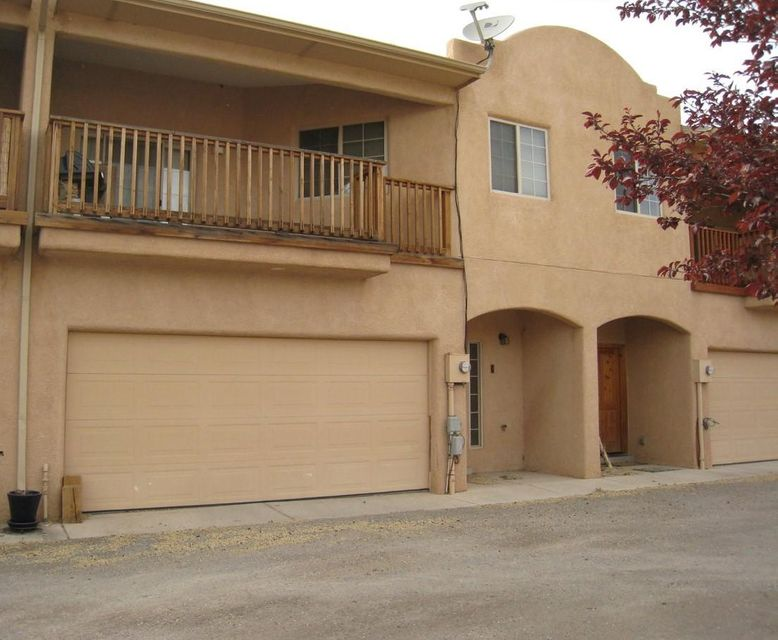 Southwestern 3Br, 1.75Ba, living room with fireplace, dining in living room, gas stove, microwave, refrigerator, dishwasher, garbage disposal, laundry room, washer & dryer hookups, carpet & tile, 2 car garage w/ opener, gas furnace, refrigerated air, ceiling fans, balcony, fenced yard, gated and mountain views. Mandatory HOA.
