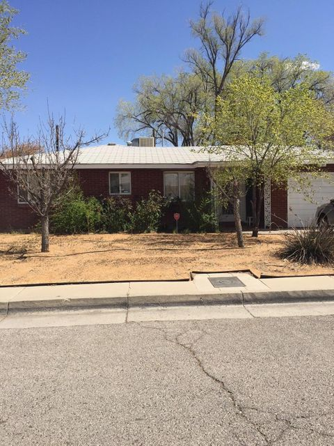 Location, Location, Location! Desirable home, close to freeway, Nob Hill, UNM, Downtown. Walk from the back yard with gate to the neighborhood park. Living room/dining room/family room with wood burning fireplace. Brick veneer. Covered Patio.