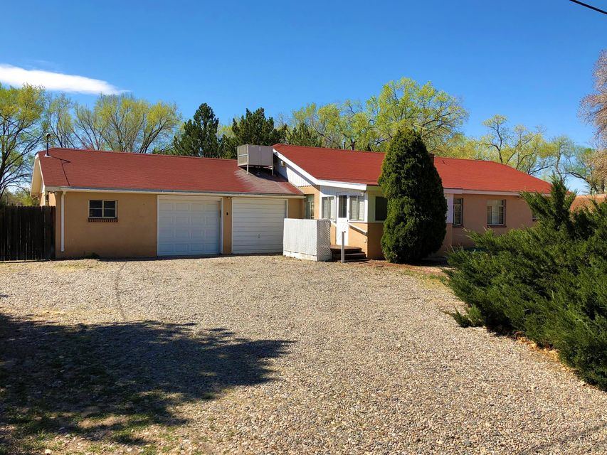Charm, history, and nature abound and await you at this wonderful retreat on a quiet dead-end street in the heart of the South Valley. Main Home offers Three bedroom /1.75 bath/ sunroom/enclosed porch is 116 sq ft not included in sq footage. 1545 sq ft in main house. Guest house is 789 sq ft.  All this on One Acre. Come make this property your own.