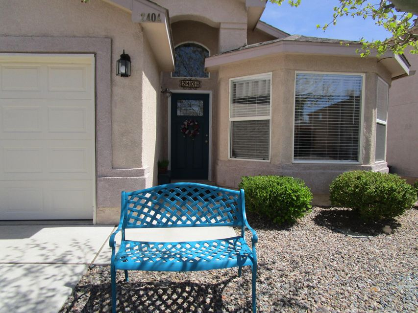 Beautiful and Move In Ready! This updated and meticulous home is in a Gated Community! REFRIGERATED Air Conditioning and Heater new in 5/2016. Pride in Ownership! This 3 Bedroom, 2 Full Bath home is squeaky clean and ready for new owners! A true 1 story with no steps in the home. You will love the cozy gas log fireplace to enjoy along with a beautifully updated kitchen with GRANITE counters and a kitchen island. Cook with gas too. Notice the pleasing paint color tones. The pergola on the back patio, the electric washer, dryer and the kitchen refrigerator and microwave stay with this home.  Call a Realtor today to show you this home!!