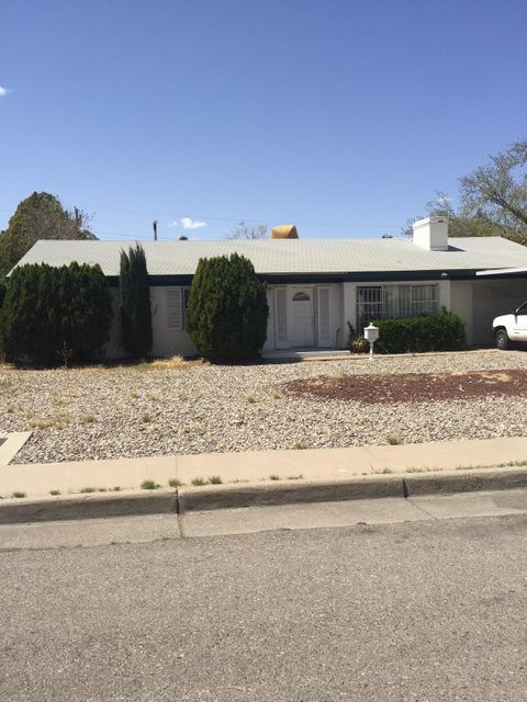 Desirable University Area. Close to UNM Golf Course, medical school, and law school. Spacious living room, with wood burning F/P, country kitchen, plus adjoining eating area. Hardwood floors. Covered patio. Large back yard with access to alley.