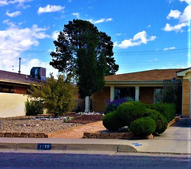 UPTOWN NE HEIGHTS: Move In Ready!! Classic brick home. Parks and walking distance to schools. Very convenient access to ABQ Uptown, Kirtland AFB, Veterans Hospital and UNM. Bus routes can take you just about anywhere. The Brick Home has new roof 10/17, remodeled kitchen, plex plumbing and a really nice 3/4 Bathroom. Wood floors in the entry, dining, kitchen and den areas.A Garden Room for enjoying plants, painting, and hobbies.The backyard is private and lovely with high walls, a great covered patio with RADER shades, storage and nice landscaping. Great Curb Appeal and cozy feeling. Bedrooms are nicely separated and the Master has a full bath. 2 car garage with storage and refrigerated air. Make this NE Heights home--yours TODAY.