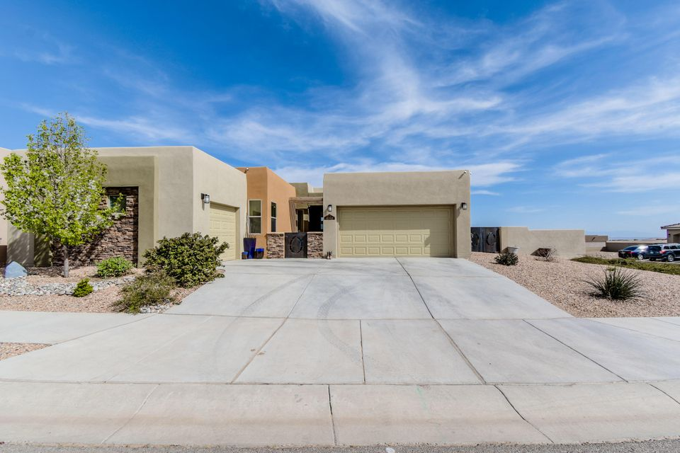 Gorgeous SW Contemporary Twilight home located in the popular Mariposa community on a large corner lot! Home features 2,012 sf with 3 bedrooms, 2.5 bathrooms and a 3- car garage! Beautiful open kitchen with upgraded espresso cabinetry and crown molding, granite countertops, detailed backsplash, gas range,  pantry and a large bar with seating area! Spacious living area with a 3-sided fireplace and a wall of sliding doors highlighting the dramatic mountain views! Master suite with views and a spa-like bath. Through the double doors find dual sinks, an oversized vanity, a large soaker tub, walk-in shower with bench and a walk-in closet! Outside take advantage of the watermelon sunset views under the covered patio! Yard also has backyard access!