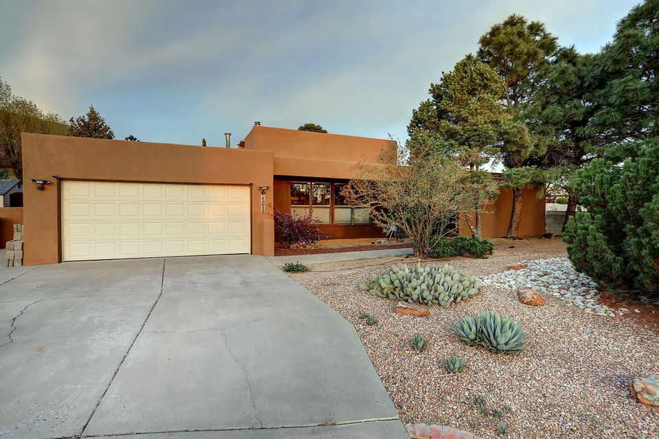 Full of Natural Light, With Amazing Sandia Mt Views, This 3 Bedroom 2 Bath Beauty is Privately located on cul de sac w South and East Facing Backyard. Two living areas, Large Office or Craft room with tons of storage with separate entrance if needed., Large bedrooms master has two closets, one is even Cedar lined. Updates include newer roof, Refrigerated A/C unit, Granite counters,All SS appliances stay with the home. Master Bath sinks,  No carpet, Great outdoor entertaining space for Family and Friends. Close to trails and all that the Foothills has to offer.