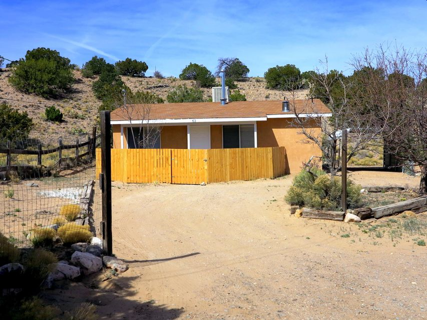 Cute as a button and ready for a new owner! Remote location with views and a lot of peace and quiet! All the amenities of a normal house with the upkeep of a tiny home! Fully updated with new interior paint, carpet, tile, cabinets, and countertops.  New water heater too! This may be your only chance to get into Placitas this year, for under $150k!!! Come see it today!