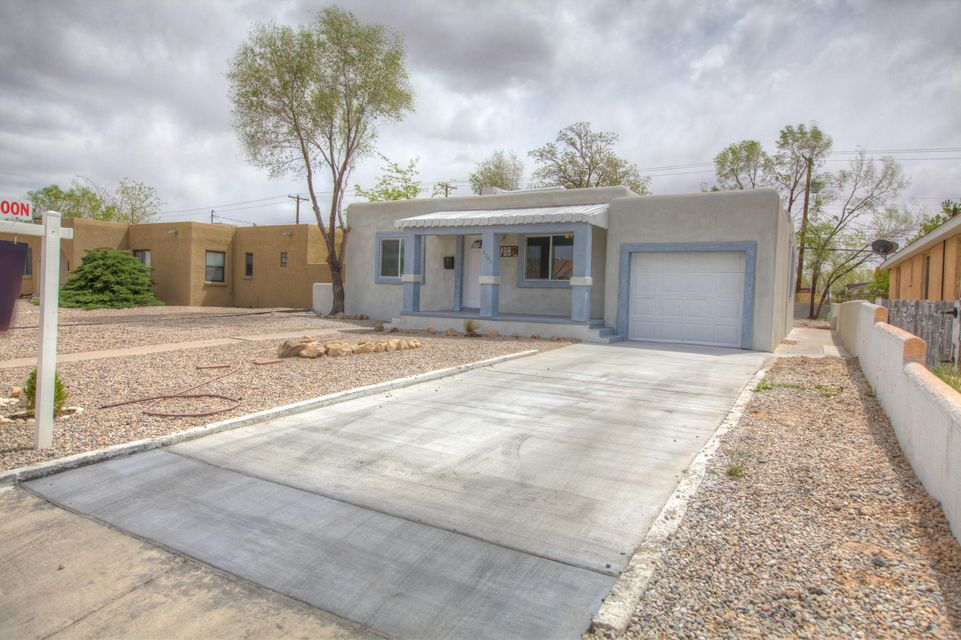 Beautiful 2 bedroom casita in UNM South area. Completely remodeled new flooring stucco windows. Enjoy this contemporarysplash of wonderful taste in this single story property. Large yard perfect for growing your own garden. Don't miss this opportunity.