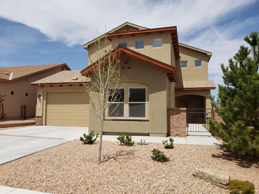 Beautiful Paul Allen NM Gold GREEN BUILT spacious 2 story home.  GREEN BUILT means lower utilities.  Open kitchen with granite countertops.  Tank less water heater and refrigerated air conditioner.  just 3 years old.  3 bedrooms upstairs with a guest bedroom/bath downstairs.
